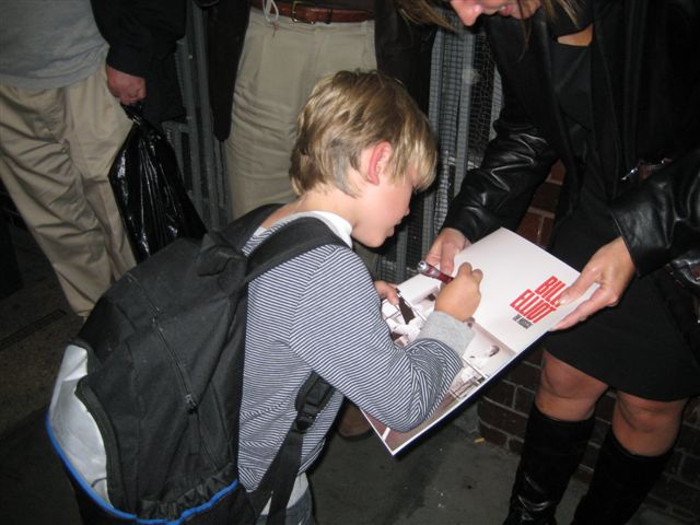 Eliot Carrington signing for the fans outside Victoria Palace Theatre, London.